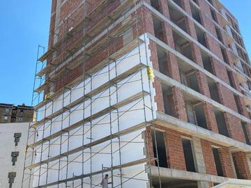 Kompani dhe Prodhusë: Fasada dhe Knauf